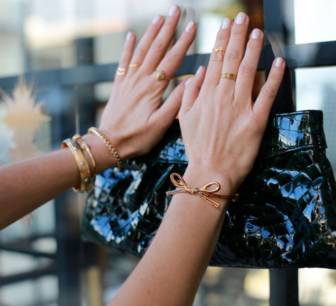 Sydne-Style-bow-bangle-kate-spade-dogeared-jewelry-how-to-stack-gold-bracelets-rings-delicate-arm-party